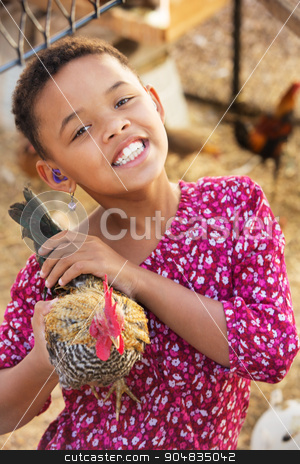 Cute Child with Hen stock photo, Cute child with hearing aid playing with hen by Scott Griessel