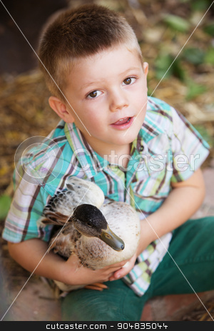 Adorable Child with Duck stock photo, Adorable child playing with little duck outdoors by Scott Griessel