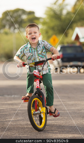 Laughing Child on Bike stock photo, Cute laughing child playing outdoors on his bike by Scott Griessel