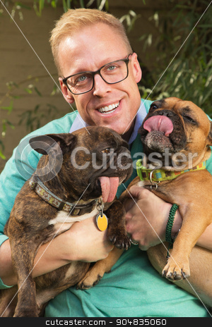 Smiling Man with Dogs stock photo, Smiling man with eyeglasses holding two dogs by Scott Griessel