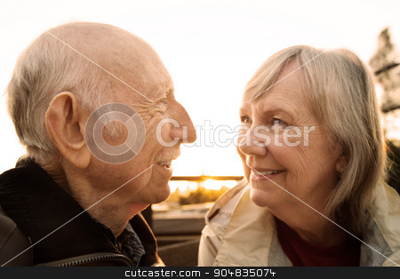 Cute Couple Looking at Each Other stock photo, Senior couple smiling and looking each other by Scott Griessel