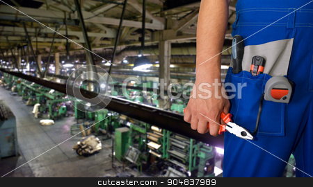 Worker with instruments stock photo, Worker with instruments at industrial factory by olinchuk