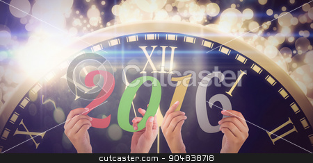 Composite image of hands showing 2016 stock photo, Hands showing 2016 against black and gold new year graphic by Wavebreak Media