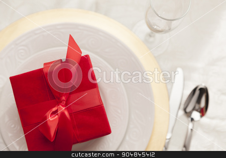 Christmas Gift with Place Setting at Table stock photo, Beautiful Christmas Gift with Place Setting Abstract at Table. by Andy Dean