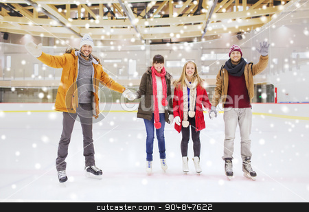 happy friends waving hands on skating rink stock photo, people, friendship, gesture, sport and leisure concept - happy friends waving hands on skating rink by Syda Productions