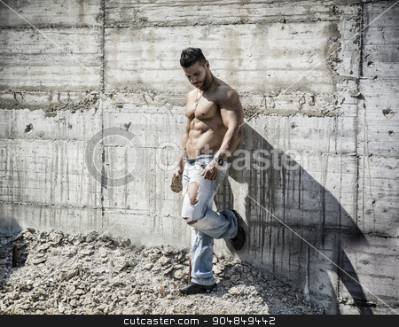 Muscular construction worker shirtless in building site stock photo, Muscle man shirtless outdoors in building site. Construction worker by Stefano Cavoretto