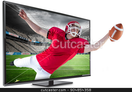 Composite image of american football player scoring a touchdown stock photo, American football player scoring a touchdown against rugby stadium by Wavebreak Media