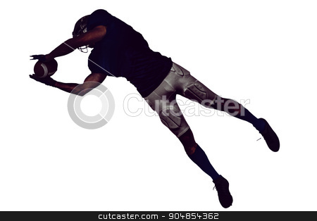 American football player catching ball in mid-air stock photo, Full length of American football player catching ball in mid-air against white background by Wavebreak Media