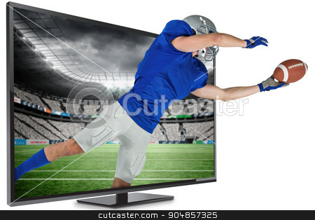Composite image of sports player catching ball stock photo, Sports player catching ball against rugby stadium by Wavebreak Media