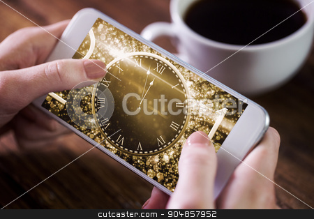 Composite image of woman using smartphone stock photo, Woman using smartphone against new year countdown graphic by Wavebreak Media