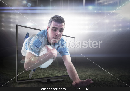 Composite image of a rugby player scoring a try stock photo, A rugby player scoring a try against american football arena by Wavebreak Media