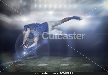 Composite image of american football player catching ball in mid stock photo, American football player catching ball in mid-air against sports pitch by Wavebreak Media