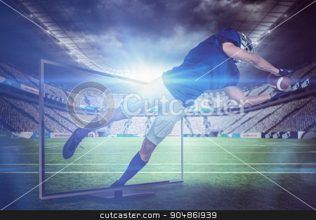 Composite image of american football player catching ball in mid stock photo, American football player catching ball in mid-air against rugby stadium by Wavebreak Media