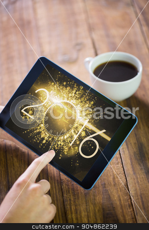 Composite image of woman using tablet pc stock photo, Woman using tablet pc against new year countdown graphic by Wavebreak Media