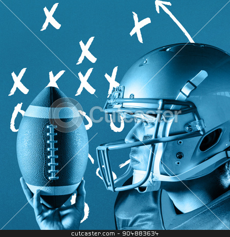 Composite image of confident sportsman looking away while holdin stock photo, Confident sportsman looking away while holding ball against blue background by Wavebreak Media
