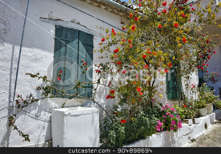 Window of the medieval house with flowers, Zakynthos island stock photo, Window of the medieval house with flowers, Zakynthos island, Greece by Stoyan Haytov