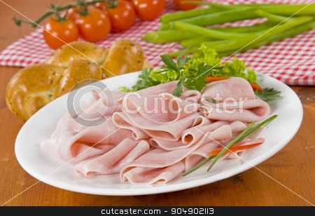 Thin slices of ham stock photo, Thin slices of ham on plate by Digifoodstock