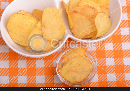 chips and peeled potato on a white plate stock photo, chips and peeled potato on a white plate by Sergey Lysenkov