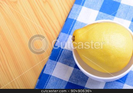 ripe lemons on a white plate stock photo, ripe lemons on a white plate by Sergey Lysenkov