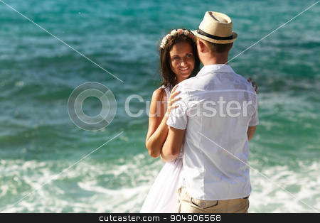 Bride standing near the water looking sea stock photo, Bride standing near the water looking  sea by Volodymyr Ivash