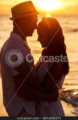 Two lovers in the sunset  happy together at vacation stock photo, Two lovers in the sunset happy together at vacation by Volodymyr Ivash