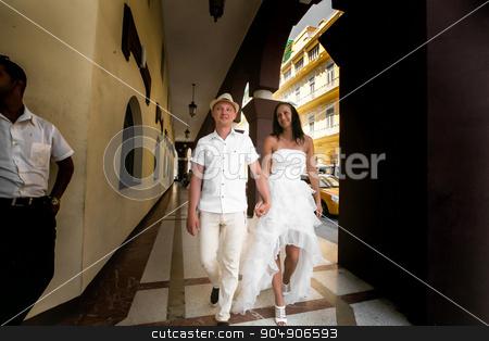 Happy wedding couple walking holding hands in old city stock photo, Happy wedding  couple walking holding hands in old city by Volodymyr Ivash