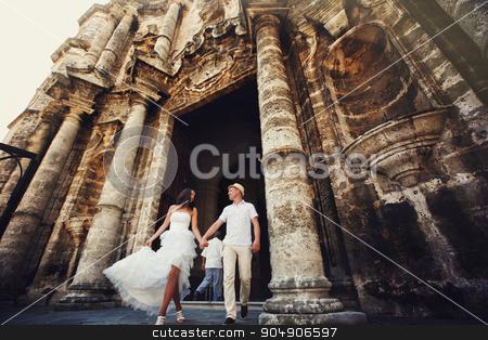 Happy wedding couple walking in old city stock photo, Happy wedding  couple walking in old city by Volodymyr Ivash