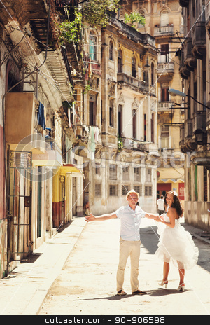 Happy couple in old city of Havana stock photo, Happy couple in old city  of Havana by Volodymyr Ivash