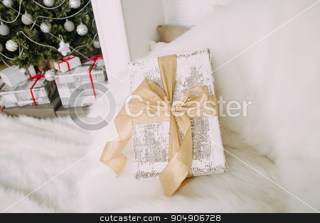 Beautiful gift on armchair stock photo, New Year's surprise on white fluffy chair by sunapple