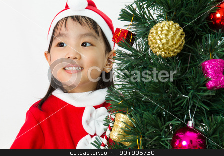 Asian Chinese little girl posing with Christmas Tree stock photo, Asian Chinese little girl posing with Christmas Tree on plain white background studio. by Tan Kian Khoon