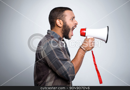 Freestyle photo with young mulatto stock photo, Young mixed race man with beard standing on grey background. Angry young man screaming with megaphone by Dmytro Sidelnikov