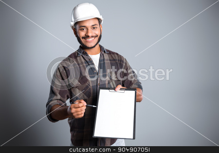 Freestyle photo with young mulatto stock photo, Young mixed race man with beard and helmet standing on grey background. Young builder smiling and proposing to fill form by Dmytro Sidelnikov
