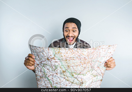 Freestyle photo with young mulatto stock photo, Young mixed race man with beard and map standing on grey background by Dmytro Sidelnikov