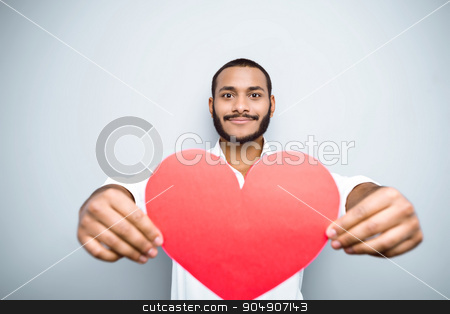 Freestyle photo with young mulatto stock photo, Young mixed race man with beard standing on grey background. Young man showing red paper heart by Dmytro Sidelnikov