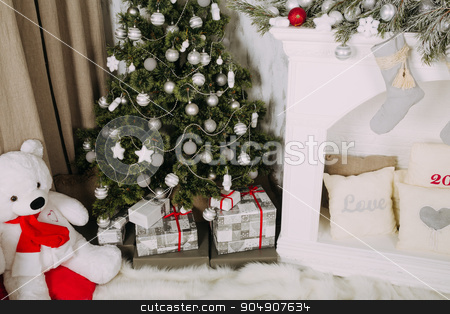 Christmas tree with gifts at fireplace stock photo, New Year's home decoration with silver Christmas balls by sunapple