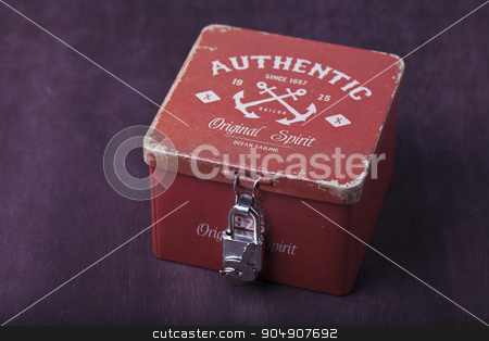 Vintage box with lock stock photo, Vintage red box on a brown background by HOMON OLEKSANDR