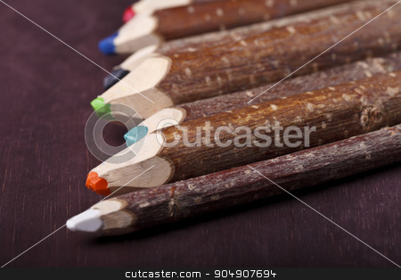 decorative pencil on a brown background stock photo, decorative colored pencils on a brown background by HOMON OLEKSANDR
