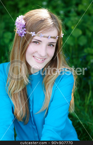 portrait of a beautiful young woman with a wreath in spring park stock photo, portrait of a beautiful young woman with a wreath in spring park. by timonko