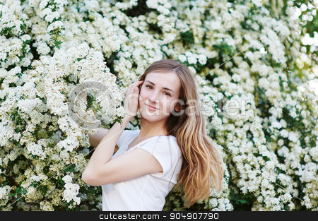 beautiful young woman walking in a blossoming spring garden stock photo, beautiful young woman walking in a blossoming spring garden. by timonko