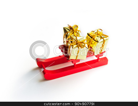 Wooden toy sledge with Christmas gifts  on shiny background stock photo, Wooden toy sledge with Christmas gifts  on shiny background. by timonko