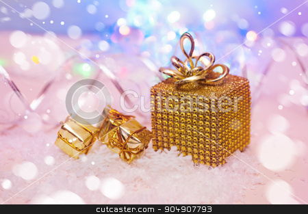 Christmas presents wrapped in gold stock photo, Christmas presents wrapped in gold. by timonko