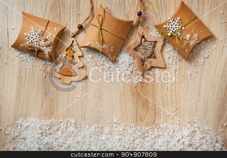 Christmas gifts in kraft paper with a homemade toys with snow stock photo, Christmas gifts in kraft paper with a homemade toys with snow. by timonko