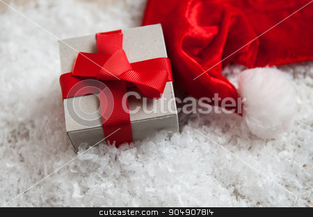 box of kraft paper from the hat of Santa Claus in the snow stock photo, box of kraft paper from the hat of Santa Claus in the snow. by timonko