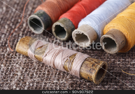 vintage bobbins with colorful threads stock photo, bobbins with colorful threads On a beautiful brown background by HOMON OLEKSANDR