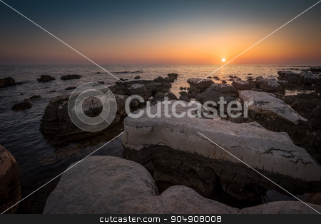 Sunset Over the Sea stock photo, Sunset Over the Sea with Rocks in Foreground by Karol Czinege