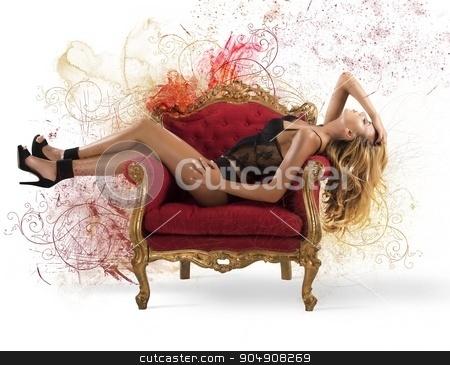 Sensual sparkling woman stock photo, Sensual woman lying on an armchair baroque by Federico Caputo