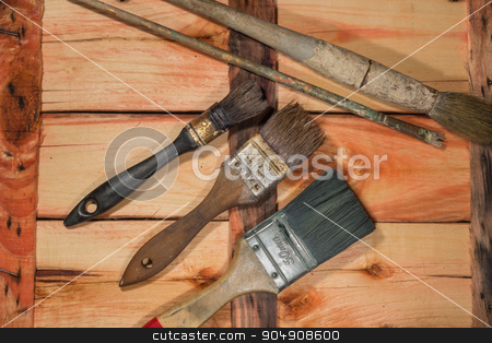 Used paintbrushes stock photo, Used paintbrushes on a old wooden table. by Alfredo Steccanella