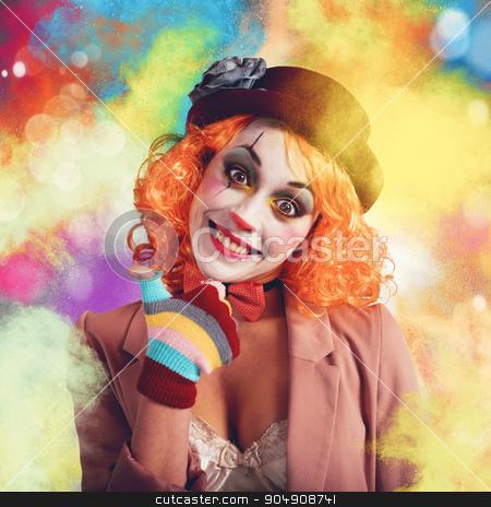 Joyful and colorful clown stock photo, Joyful and smiling clown between multi-colour powders by Federico Caputo