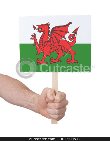 Hand holding small card - Flag of Wales stock photo, Hand holding small card, isolated on white - Flag of Wales by michaklootwijk