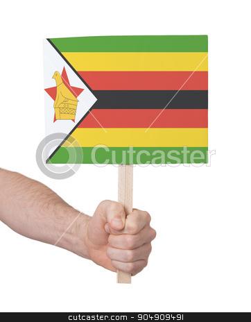 Hand holding small card - Flag of Zimbabwe stock photo, Hand holding small card, isolated on white - Flag of Zimbabwe by michaklootwijk